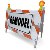 Remodel Barricade Road Building Construction Sign Renovation Imp. Remodel word on a road construction sign to illustrate a renovation, redo, improvement project Royalty Free Stock Photos