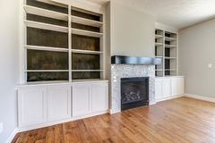 Free Remodel Of Some Built-in Shelving Around A Fireplace. Royalty Free Stock Image - 125609416