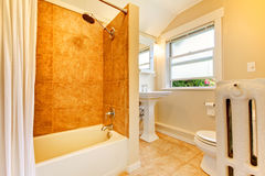 Remodeled bathroom with window and gold tiles. royalty free stock photo