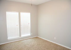 Remodeled Bedroom. Freshly painted new carpeted bedroom Stock Photos