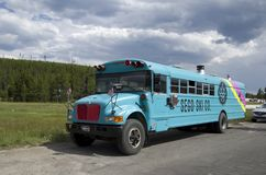 Remodeled bus park in Yellowstone. A school bus was remade into a mobile home parked in Yellowstone National Park in Summer stock images