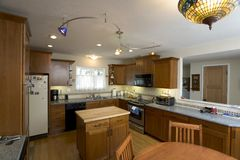 Remodeled Cherry Kitchen. Shot of a recently remodeled kitchen with cherry cabinets Royalty Free Stock Photo