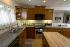 Remodeled Cherry Kitchen. Shot of a recently remodeled kitchen with cherry cabinets Royalty Free Stock Photography