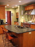 Remodeled, kitchen. Newly remodeled kitchen with stainless, wood and stone countertops Royalty Free Stock Photo