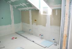 Remodeling attic bathroom with drywall repair, plastering painting, stucco. Bathroom repair and renovation. With gypsum plaster boards stock photography