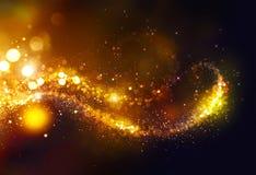 Remolino de las estrellas de la Navidad que brilla de oro sobre negro imagenes de archivo