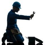 Remontowa mężczyzna pracownika rozpacza modlenia sylwetka Fotografia Stock