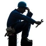 Remontowego mężczyzna pracownika smutna zmęczenia niepowodzenia sylwetka zdjęcia stock