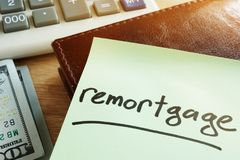 Remortgage concept. Calculator and money. Stock Photo