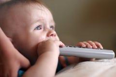 remote младенца сдерживая Стоковая Фотография