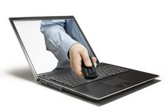 Remote. A hand reaching out of a computer stock image