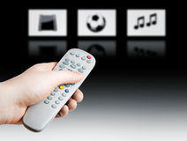 Remote. Hand holding a TV remote control on gradient background Stock Photography