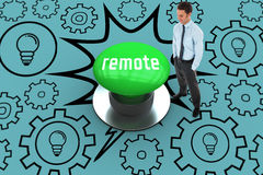 Remote against digitally generated green push button Royalty Free Stock Photos