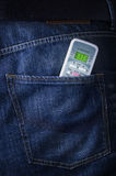 Remote from air conditioner in jeans poket Royalty Free Stock Image
