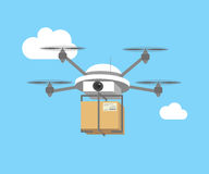 Remote air drone with a box. Flying in the sky Royalty Free Stock Photo
