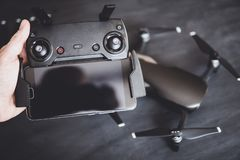 Remote with antennas and a smartphone to control the drone in the hands. The concept of using drones in life and industry. Innovation photography concept. Mate royalty free stock photo
