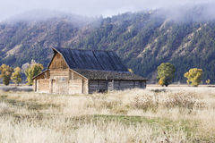 Remote Barn in an Open Field Stock Images