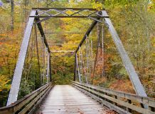 REMOTE BRIDGE IN THE TENNESSEE FALL WILDERNESS. The Fall leaves and colors on this wilderness hike were vivid and stunning. After crossing the bridge over this Stock Photography