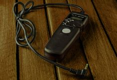 Remote camera shutter release on wooden table stock photography