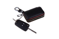 Remote car key and leather case isolated on white background royalty free stock photography