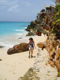 Woman walking on remote Caribbean Island beach Royalty Free Stock Photos