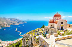 Remote church with red roofing on cliff, Greece Royalty Free Stock Photo