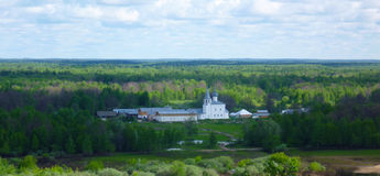 Remote from civilization, a convent nestled in the forest on the plain. Amid the forest, Royalty Free Stock Photos