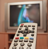 Remote comtrol for tv. A remote comtrol for a TV. Narrow DOF of a image stock photos