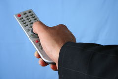 REMOTE CONTROL. Hand with remote control Stock Photos