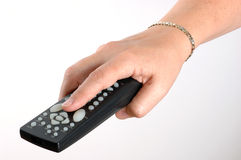 Remote Control. Female hand holding a remote control isolated on a white background Stock Image