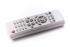 Remote control. Of plastic gray with colored buttons on a white background stock photos