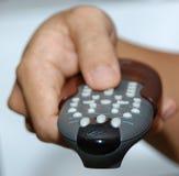 Remote Control. Person holding the remote contro Stock Photo