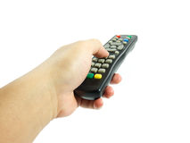 Remote Control. Hand holding remote control isolated on white background royalty free stock photo