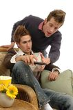 Remote Control. Two guys fighting over the remote control Royalty Free Stock Image