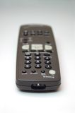 Remote Control. A remote control on a table Royalty Free Stock Image