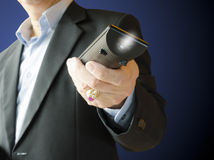 Remote Control. Business man using remote control , on blue background Royalty Free Stock Photos
