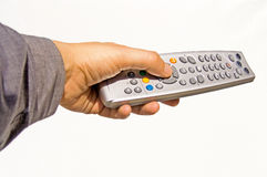 Remote control. Hand with remote tv control Stock Photography
