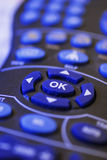 Remote control. A remote control with blue buttons Stock Image