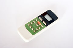 Remote control. A remote control air-conditioned white background Stock Photography