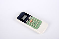 Remote control. A remote control air-conditioned white background Royalty Free Stock Image