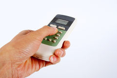 Remote control. And a remote control in hand on a white background Royalty Free Stock Photography
