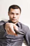 The remote control. Man with remote control in the hand Royalty Free Stock Images