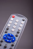 Remote control. DVD player remote control on grey stock photo