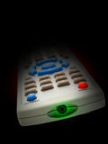 Remote Control. A front view of a television / DVD remote control, isolated on a black background royalty free stock image