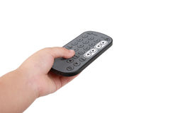 Remote control. Little hand with remote tv control royalty free stock images