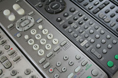 Remote control background. Background made of several remote controls Stock Image