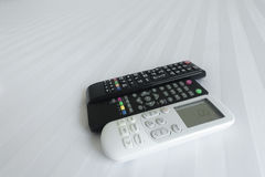 remote control on Bed linen stock images