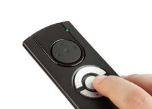 Remote control with blank buttons in hand Royalty Free Stock Images