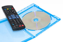 Remote control with blu-ray disc movie. The picture shows a blu-ray disc with a remote control to show a scene of watching a movie Royalty Free Stock Photos