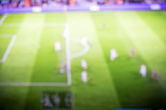 Remote control broadcast TV stands on the table, sport football TV screen background stock image